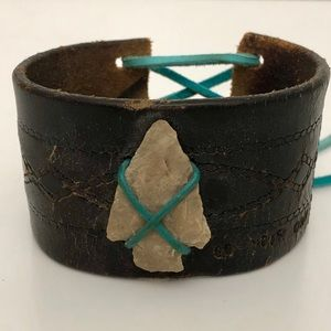 Arrowhead on leather cuff with teal corset closure